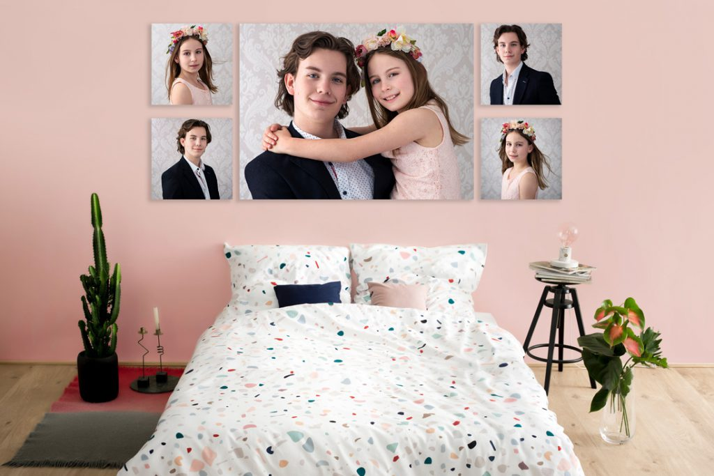 five family portraits of siblings presented on pink bedroom wall